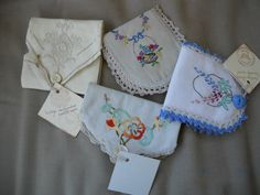 a collection of little needle cases made from recycled vintage doileys. They…