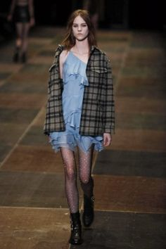 Designer work inspired by 1990s fashion: Yves Saint Laurent designed a grunge look inspired from the 1990's.  He had his models wear plaid shirts and fish nets which were both popular pieces in the grunge fashion era.