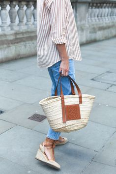 2524b49b751 Emma Hill wears stripe shirt, loewe basket bag, light wash jeans, wedge  espadrilles