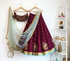 Stunning maroon color lehenga and crop top with powder blue color net dupatta. Lehanga and crop top with hand embroidery gold thread work. 31 October 2017