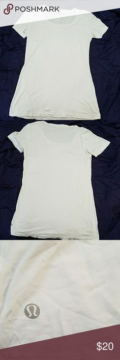 Lululemon t-shirt White shirt with a slight scoop neck. Extremely comfortable and soft. It's great for yoga things, running, outdoor activities, or with a cute pair of jeans. I have only worn it in social occasions, so it's in good condition. No holes or tears. lululemon athletica Tops