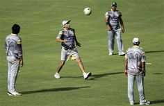 Pakistan's cricketer Younis Khan, second left, takes part in a warm up game with others during a practice session ahead of their second one day international cricket match against Sri Lanka, in Pallekale, Sri Lanka, Friday, June 8, 2012.