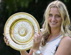 Czech tennis player Petra Kvitova holds the trophy of the All England Lawn Tennis Championships in Wimbledon at the press conference in Prague, Monday, July 7, 2014. She won the women's singles final against Eugenie Bouchard of Canada. (AP Photo,CTK/Roman Vondrous) SLOVAKIA OUT ▼11Jul2014AP|Man arrested after alleged threats against Kvitova http://bigstory.ap.org/article/man-arrested-after-alleged-threats-against-kvitova #The_Championships_Wimbledon_2014 #Petra_Kvitova