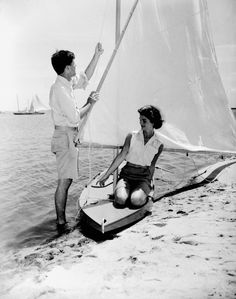 mrs-kennedy-and-me:  John F. Kennedy playing on the beach with his fiance, Jacqueline Bouvier, summer of 1953.