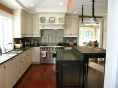 So white kitchen cabinets and dark counter, maybe island with dark cabinets and butcher block