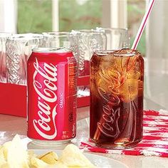coke can glass!  I found these at a thrift store!  Except I use them for wine, hahaha, classy I know