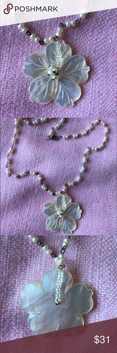 Mother of Pearl Shell Plumeria Necklace This beautifully carved mother of pearl shell necklace features the elegant simplicity of the favorite island flower; with five petals that symbolize; Sincerity, Faith, Devotion, Aspiration, and Surrender. 🌺 🐚 Gently used-in great condition! Jewelry Necklaces