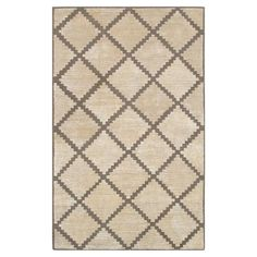 Cream and tan wool harlequin-style rug.