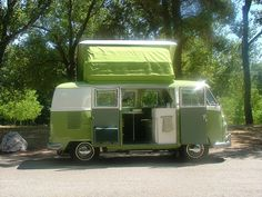 '66 VW Camper Split Window in green on green . We had one of these in beige. Our family had lots of fun camping in this. It had a tent that would go out from the side door too. Great memories!!!