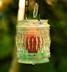 Vintage glass light cover repurposed in to hanging candle holder
