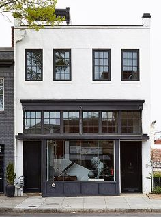 """Located in Washington DC's Shaw neighborhood, Darryl's boutique captures """"a rare example of pre-Civil War architecture."""" You are in the right place about facade ideas Here we offer you the most beauti Building Exterior, Building Facade, Building Design, Facade Design, Exterior Design, House Design, Retail Facade, Luxury Store, Shop Fronts"""