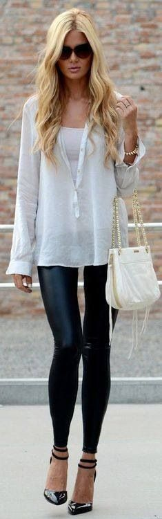 White shirt with black leather leggings.