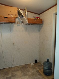 When we first moved in to our double wide mobile home, it wasn't exactly what you would call my dream home. The laundry room was just plain horrible and ugly! B…