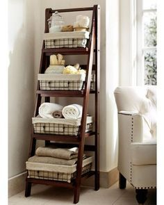 Bathroom Storage that could double for linen storage as well when closets are limited.