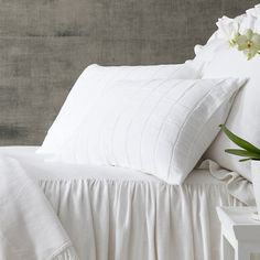Pine Cone Hill Tribeca White Matelassé Sham Made from superlightweight, deconstructed cotton in classic white, contemporary grid weave, this matelassé sham is an delightfully cozy way to dress up any bed.