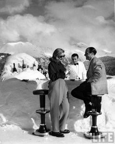 Midday cocktails being served at bar made of snow on private ice rink at the Palace Hotel in fashionable winter resort St. Moritz, Switzerland 1947. Photo by Alfred Eisenstaed.