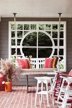 A designer's charming and beautiful beach house! From New England Home. Colorful and fun patio.