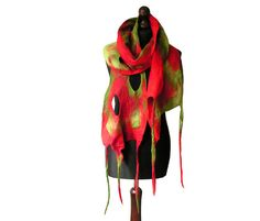 Felted scarf made from finest Australian merino wool. Lightweight and soft to the touch. Colors: shades of red, shades of green.  Size: length: