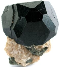 Pleonast, also once known as ceylanite or ceylonite, is a dark colored variety of spinel.