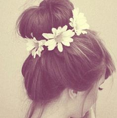 Delicate and subtle beauty found within her adorable bun hugged with flowers. Find the best hair accessories at Duane Reade.