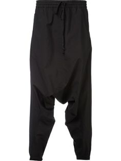 LOST AND FOUND lightweight drop crotch over-pants. Black viscose blend lightweight drop crotch over-pants from Lost And Found featuring an elasticated waistband, a drawstring fastening and zipped side pockets.