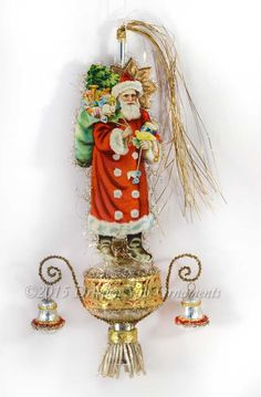 Dresden Star Ornaments - Victorian Santa with Bird and Toys on Silver Glass Topper with Antique Bells, $295.00 (http://www.victorianornaments.com/victorian-santa-with-bird-and-toys-on-silver-glass-topper-with-antique-bells/)