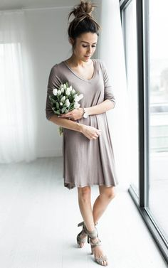 Ily Couture Mocha V Neck Dress Our NEW Mocha V Neck Dress is our season must have. It's so soft and a perfect flow material, so it's very flattering. This Mocha V Neck Dress features a V neck detail and a three quarter length sleeve. Model is wearing size small.