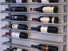 Ikea towel racks as wine rack. Not cheap, but very attractive. Could be used for canned food storage inside a pantry (maybe with something less expensive)