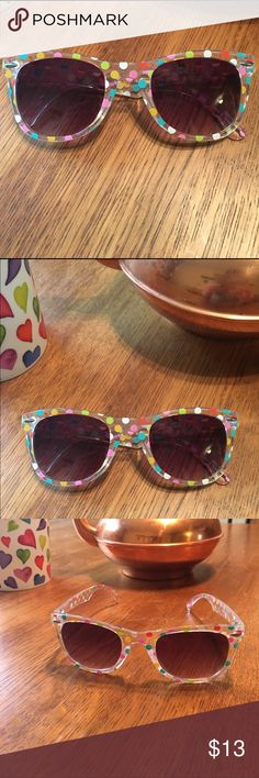 Polka Dot Sunglasses NWOT. Cute wayfarer style sunglasses. Clear plastic frames with multi colored pastel polka dots. Kids's Sized for small adult faces or big kids. Accessories Sunglasses