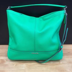 Get your grad this gorgeous green #coach hobo to celebrate all their hard work!   #cmselma #designerbagsforless #cmsavings