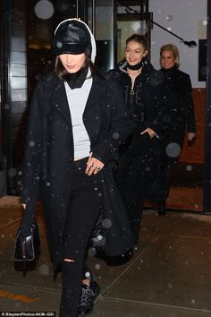 Girls night: They braved the cold as they headed back out into the snow...