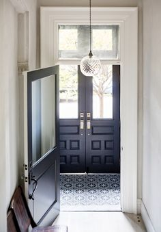 Black and white entryway with large doors