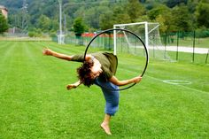 Beautiful barrel jump while isolating the hoop -- Brecken Rivara photographed by See Ying hoop spirit