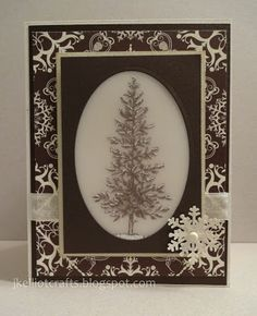"By Katherine Elliot. Uses Stampin' Up ""Lovely as a Tree"" set. Stamp in Earl Espresso ink onto vellum. Flip vellum to back & add snow accents with white gel pen. Layer vellum onto ivory cardstock lightly sponged with River Rock & place behind oval window cut into cardfront. Add embellishments."