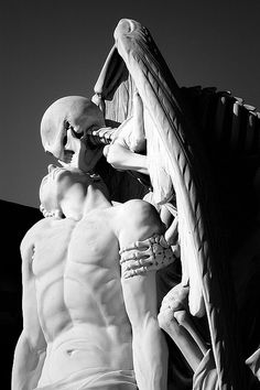 A winged skeleton bestows a kiss on the forehead of a handsome young man: is it ecstasy on his face or resignation? Little wonder the sculpture elicits ...