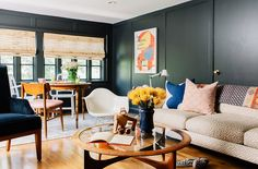 mixed prints on the sofa + black walls and wood (Gen Sohr; Inside a Fabulously Fresh Nashville Home)