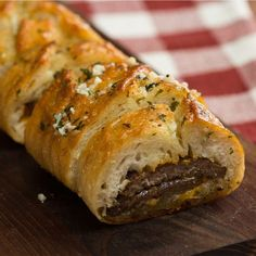 Take garlic bread to the next level by stuffing it with meaty, cheesy deliciousness.
