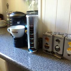 Tassimo pod storage idea DIY: take a Pringles tube, spray it silver and carefully slice an opening so that the pods can come out of the base.  Looks really cool and 100% recycled/upcycled!