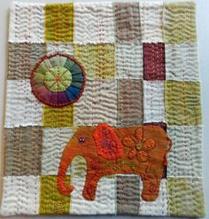 Under the African Sun, embroidered quilt, by Kristin Shields.