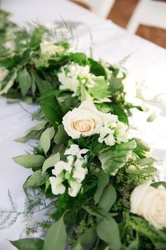 This garland used for the ceremony altar was re-purposed for the bridal party reception table