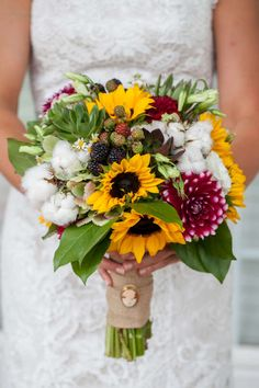 Swoon Floral Design, Bridal bouquet of yellow sunflowers, blackberries, burgundy dahlias and cotton.