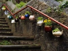 "Teapots without lids are cheap and plentiful at thrift stores but they are not functional. Here is a great use for them! [   ""Tea pot planters hanging in the garden, Cool Idea. I don"