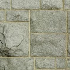 Create the appearance of a stone wall without the cost by painting faux stone.