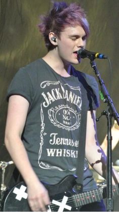 Michael Clifford in a Jack Daniels t shirt!!!!!  just let me go cry in the corner please. Nothing could possible be better than this lol