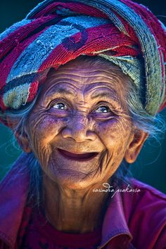 An Old Balinese woman with her Joyous face....so alive