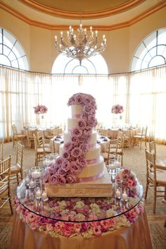 Talk about platinum wedding idea! cover table with flowers add a few risers and top with glass
