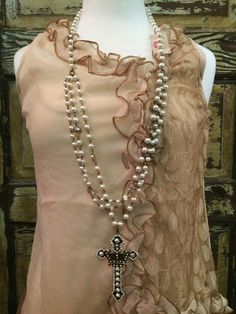 The Bling Box - Pink Panache 18 inch 3-Stranded Cream Pearl Necklace with a 4 inch Cross Pendant with AB Swarovski Crystals, $89.99 (http://www.theblingboxonline.com/pink-panache-18-inch-3-stranded-cream-pearl-necklace-with-a-4-inch-cross-pendant-with-ab-swarovski-crystals/)