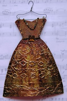 paper dress with texture on hanger and music score background