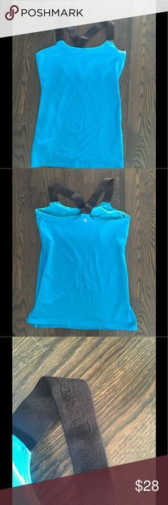 Lululemon tank with built-in bra Blue and black tank by Lululemon with built-in bra! This top is super comfortable and has black straps with Lululemon written on them! lululemon athletica Tops Tank Tops