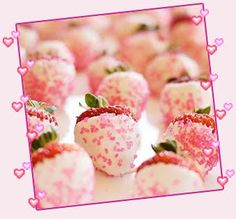 A Neat, Easy To Make Party Dessert...Whole, Capped Strawberries (With Stems Left On), Dipped In Melted White Chocolate, Rolled In Pink Sprinkles and Topped With A Dab of Dark Pink Icing...Tube Icing Would Work Perfectly!!  Love This...For All Parties, But Especially Baby Showers and Birthday Parties...!!